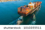 container cargo ship in import... | Shutterstock . vector #1010355511