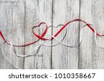 red and white ribbon hearts for ... | Shutterstock . vector #1010358667