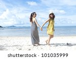woman happy together on sand beach with blue sky background - stock photo