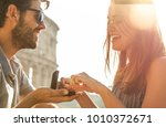 happy young couple in love... | Shutterstock . vector #1010372671