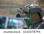 Binocular Night Vision Device on Military Helmet. - stock photo