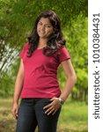 beautiful young girl posing...   Shutterstock . vector #1010384431