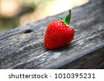 Strawberries Are Placed On Old...
