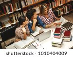 Small photo of Group of female students study in the school library.Learning and preparing for university exam.Education concept.