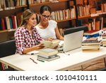 two female students study in... | Shutterstock . vector #1010410111