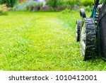 mowing lawns  lawn mower on... | Shutterstock . vector #1010412001