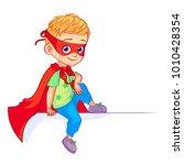 little cute super boy sitting... | Shutterstock .eps vector #1010428354