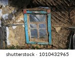 window and mud wall of... | Shutterstock . vector #1010432965