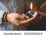 the man holding brushed chrome... | Shutterstock . vector #1010456014