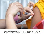 Small photo of Vaccination for girls to prevent cervical cancer,preventive inoculation image,Doctor giving a female patient injection in hospital,healthcare and medicine.
