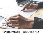 business women reviewing data... | Shutterstock . vector #1010466715