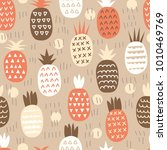 painted pineapple on a beige... | Shutterstock .eps vector #1010469769