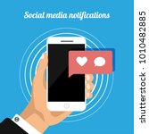 hand holds phone with social... | Shutterstock .eps vector #1010482885
