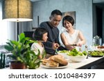 happy asian family preparing... | Shutterstock . vector #1010484397