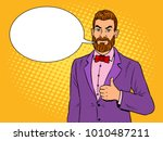 stylish man with beard showing... | Shutterstock .eps vector #1010487211