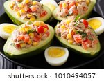 delicious snack of avocado... | Shutterstock . vector #1010494057