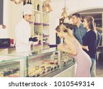 positive pastry chef male is... | Shutterstock . vector #1010549314