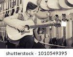 teenager is choosing quality... | Shutterstock . vector #1010549395