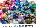 various tumbled bright coloured ... | Shutterstock . vector #1010577271