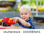 little  two years old boy... | Shutterstock . vector #1010585641