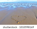 the single heart drawn on the... | Shutterstock . vector #1010598169