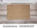 blank tan colored coir doormat... | Shutterstock . vector #1010640109