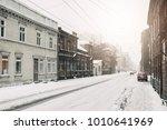 heavy snowfall in the city.... | Shutterstock . vector #1010641969