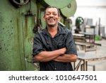 portrait of worker on factory... | Shutterstock . vector #1010647501