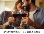 couple clink glasses with red... | Shutterstock . vector #1010654281