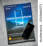 Small photo of PARIS, FRANCE - APR 26, 2017: Unbox Your phone advertising campaign for Samsung Galaxy Smartphone S8 from Orange Telecom with Apple iPhone smartphone SE on cover