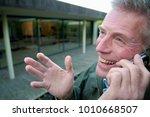 happy senior on phone   Shutterstock . vector #1010668507
