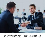two business colleagues shaking ...   Shutterstock . vector #1010688535