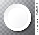 empty plain white plate on a... | Shutterstock .eps vector #1010700211