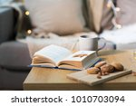 hygge and cozy home concept  ...   Shutterstock . vector #1010703094