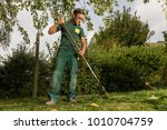 gardener cleaning the lawn  | Shutterstock . vector #1010704759
