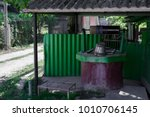 old well with water in village  ... | Shutterstock . vector #1010706145