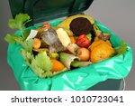 trash bin full of organic... | Shutterstock . vector #1010723041