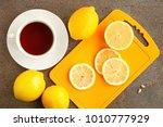 tea with lemon on a gray...   Shutterstock . vector #1010777929