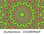 Small photo of abstract background of floral pattern of a kaleidoscope. pink blue green background fractal mandala. abstract kaleidoscopic arabesque. geometrical ornament flower pattern