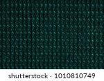 green fabric texture background....   Shutterstock . vector #1010810749