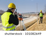 Land Surveyors Measuring With...