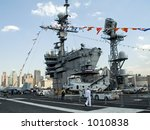 This is a shot of the deck of an aircraft carrier docked in New York during Fleet Week. - stock photo