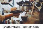 barista make coffee latte art...   Shutterstock . vector #1010845309