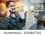 smiling young man having phone... | Shutterstock . vector #1010847181
