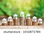 paper house on coins stack for... | Shutterstock . vector #1010871784