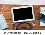 high angle shot of tablet and... | Shutterstock . vector #1010915551