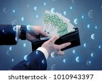 businessman's hand takes out... | Shutterstock . vector #1010943397