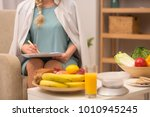 nice dietitian in white gown... | Shutterstock . vector #1010945245