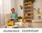 beautiful dietitian sitting in... | Shutterstock . vector #1010945269