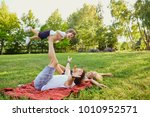 happy family in the park.    Shutterstock . vector #1010952571